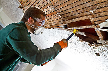 An Xtreme Home Improvement technician performing remediation services.